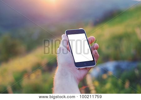 Men's Left Hand Is Holding A Phone