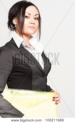 Close up of woman with folder in hands