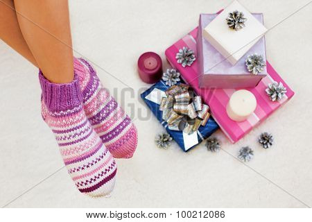 Photo Of  Feet With Christmas Socks, Top View Point And Christmas Gifts