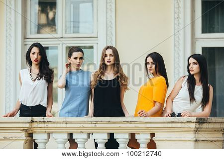 Five beautiful young girls in dresses