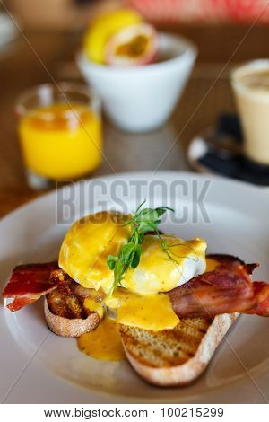 Delicious breakfast with eggs Benedict and juice