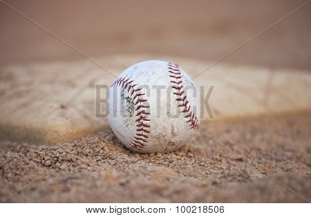 Selective Focus Low Angle Of Grungy Baseball And Base