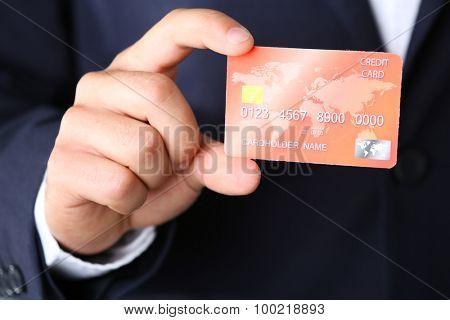 Businessman holding credit card,  close-up