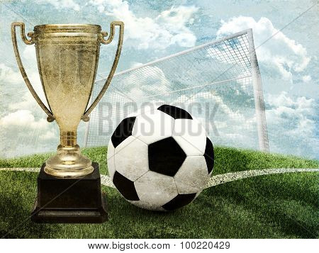Cup with football and gates
