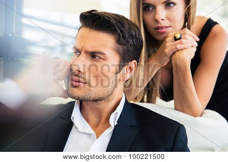 Confident businessman talking on the phone in restaurant