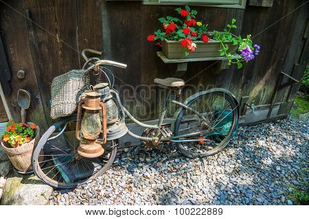 old vintage bike and lanterns leaning against wall