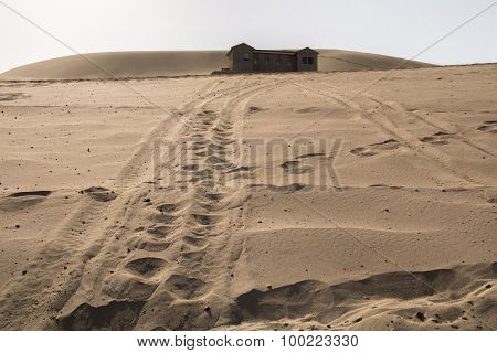 Sandune In The Desert With Plublic Toilet