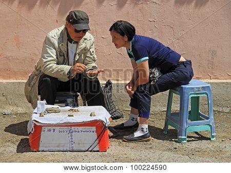 two street sellers are conversating in Ulaanbaatar