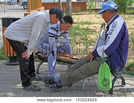 two men are playing checkers in park of Ulaanbatar, Mongolia