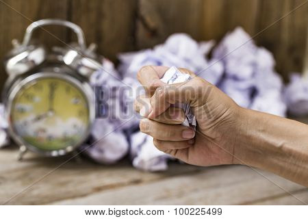Hand Holding Crumpled Paper In The Office Hour