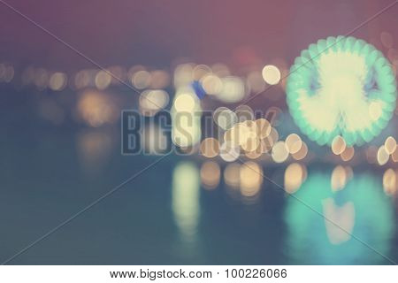 Blurry Bokeh Night Harbor Lights Background With Ferris Wheel