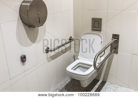 Toilet With Handrails For The Disabled