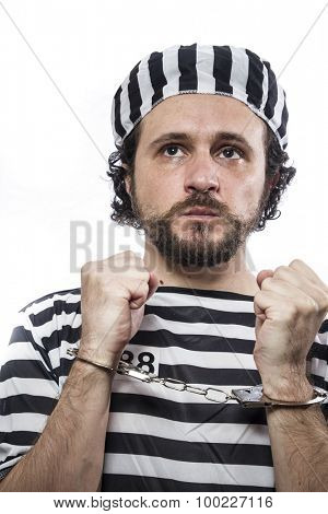 Incarcerated, Desperate, portrait of a man prisoner in prison garb, over white background