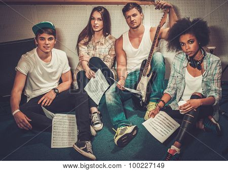 Multiracial music band in a recording studio
