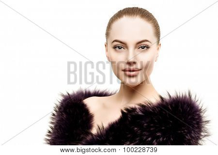 Woman in a fur coat. Young beautiful model in winter outerwear. Stylish luxury girl on a white background