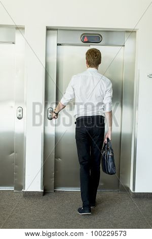 Young Businessman In Front Of  Elevator