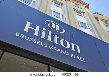 The Logo Above The Main Entrance Of The Hilton Hotel