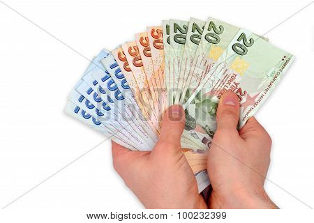 Turkish Lira Held On A White Background