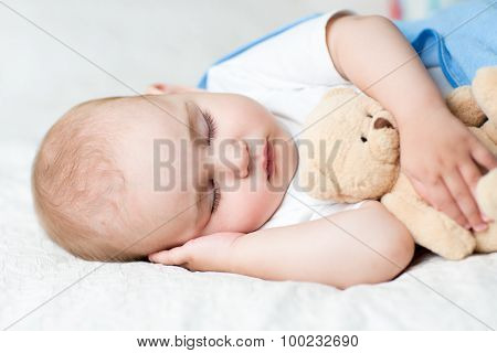 Carefree sleep baby with soft toy