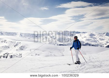 Young woman doing ski touring - winter holidays