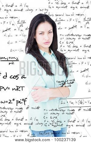 Serious woman looking at camera against rocket science theory