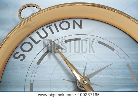 Compass pointing to solution against bleached wooden planks background