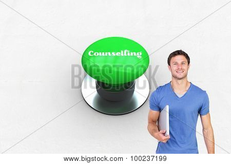 The word counselling and smiling man with closed laptop against digitally generated green push button
