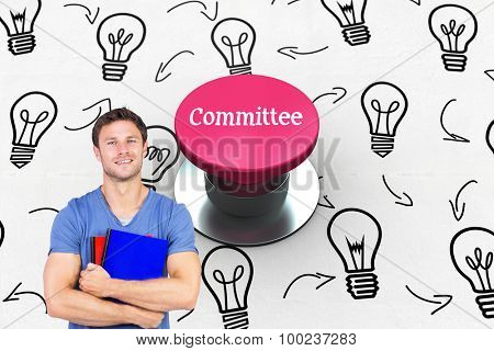 The word committee and smiling man looking at camera against pink push button