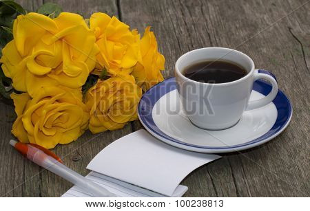 Notebook With The Handle, Coffee And A Bouquet Of Bright Yellow Roses
