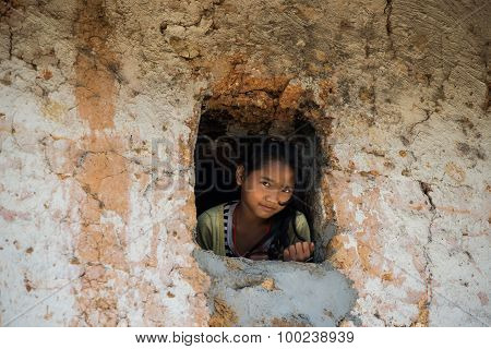 H'Mong ethnic minority kid in a windows in Laocai