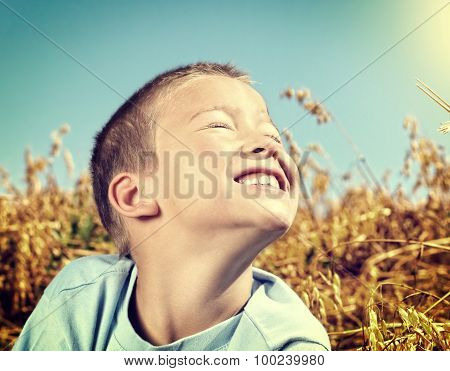 Happy Kid In The Field