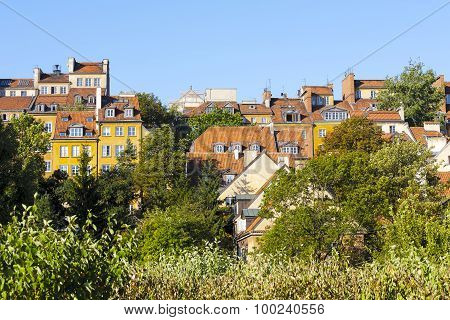 Townhouses Over The Green Vegetation In Warsaw