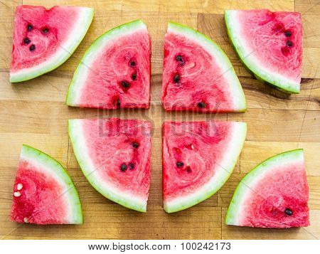 Watermelon slices arranged in a circle shape and around