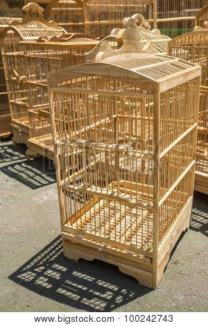 Wooden cages for birds at the Pasar Ngasem Market in Yogyakarta, Java, Indonesia.