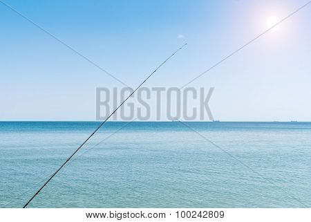 Fishing Rods On The Background Of Blue Water