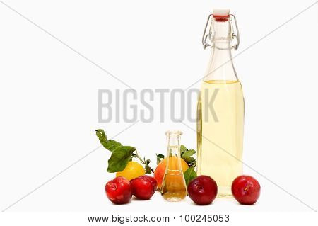 A Bottle Of Homemade Plum Brandy With Fresh Plums