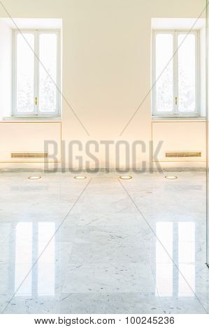 Bright Clear Gallery Wall With Two Windows And Marble Floor