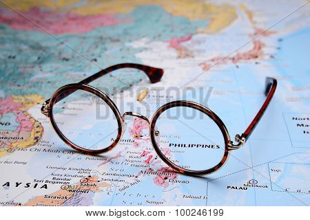Glasses on a map of Asia - Philippines