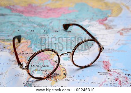 Glasses on a map of Asia - Thailand