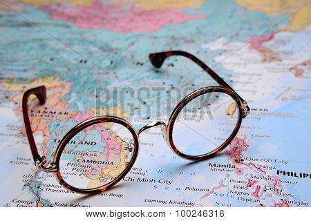 Glasses on a map of Asia - Phnompenh