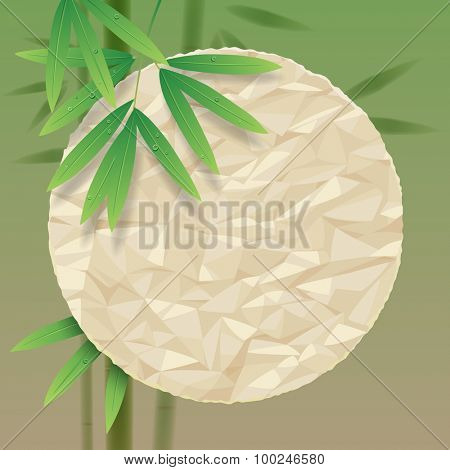 Green background with a crumpled paper round and bamboo stems and leaves