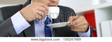 Businessman In Suit Drinking Hot Fresh Morning Cup Of Coffee