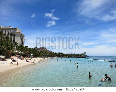 People Play In The Water And Hang Out On The Beach In World Famous Tourist Area Waikiki
