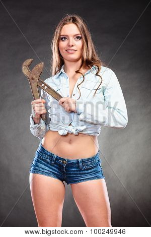Seductive Woman Holding Monkey Wrench. Feminism.