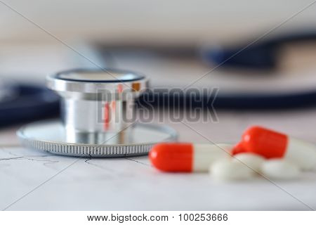 Medical Stethoscope Head Lying On Cardiogram Chart