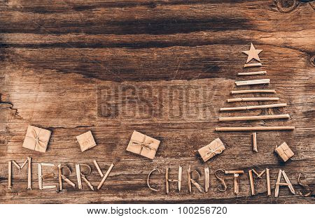 Christmas Tree And Gift Box On Vintage Wood