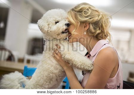 Girl his white curly Bichon Frise dog