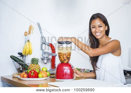 Woman about to liquefy ingredients for a homemade almond milk