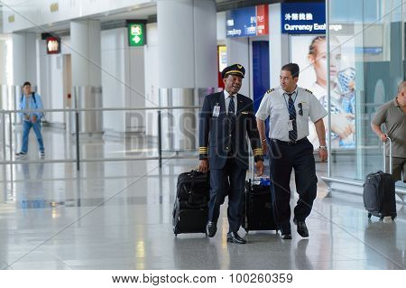 HONG KONG - APRIL 15, 2015: pilots of United Airlines after flight. United Airlines, Inc. is an American major airline headquartered in Chicago, Illinois