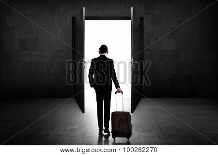 Back View Of Business Man Standing Toward Door